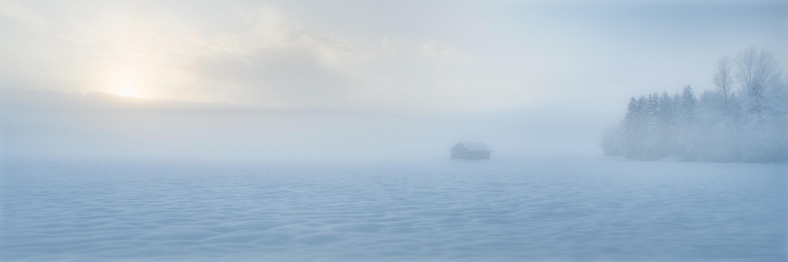 sunrise above a foggy snow field
